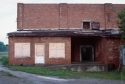 The exterior of an abandoned warehouse in rural Illinois, where the following images were first shown. After gaining access, I spent several months renovating and wiring the interior for lights.